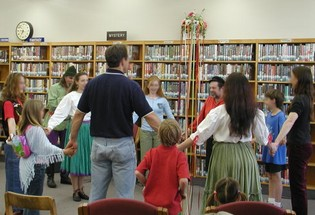 Learning a folk dance at a library